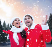 Festive couple against snowy landscape — Foto de Stock