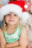 Girl wearing santa hat at home — Stock Photo