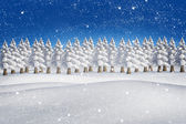 Composite image of fir trees in snowy landscape — Stock Photo