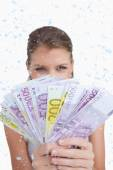 Cute woman showing bank notes — Stock Photo