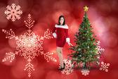 微笑在圣诞老人衣服的漂亮女孩 — 图库照片