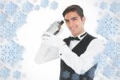 Handsome barkeeper shaking a drink — Stock Photo