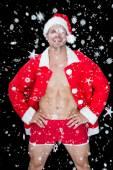 Muscular man posing in sexy santa — Stock Photo