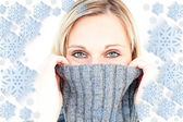 Delighted woman wearing a poloneck-sweater — Stockfoto