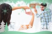 Happy young couple putting up picture frame — Stok fotoğraf
