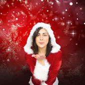 Pretty girl in santa outfit blowing — Stock Photo