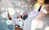 Young winter couple against — Stock Photo