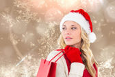 Festive blonde with shopping bag — Stock Photo