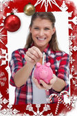 Portrait of a woman putting a note a piggy bank — Stock Photo