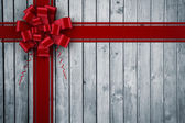 Composite image of red christmas bow and ribbon — ストック写真