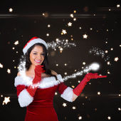 Girl presenting in santa outfit — Stock Photo
