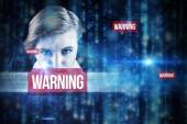 Word warning and focused businesswoman — Stock Photo