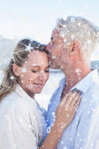 Man kissing his smiling partner on the forehead — Stock Photo