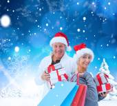 Couple with shopping bags and gifts — Стоковое фото