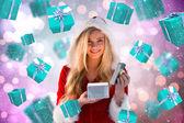Sexy santa girl opening gift — Stockfoto