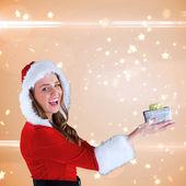 Sexy santa girl holding gift — Stock Photo