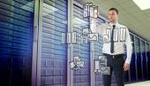 Businessman writing against server room — Stock Photo