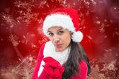 Festive brunette blowing — Foto Stock