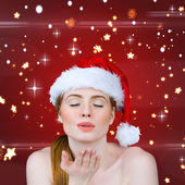 Sexy santa girl blowing kiss — Stockfoto