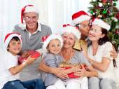 Smiling family at christmas — Stock Photo