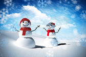 Composite image of snow man family — Stock Photo