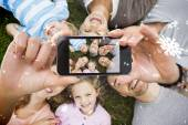 Extended family lying in circle at park — Stock Photo