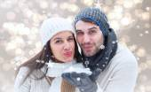 Young winter couple against — Foto Stock