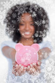 Pink piggy bank held by a woman — Foto Stock
