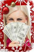 Blonde hiding her face with dollars banknotes — Stock Photo
