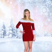 Composite image of pretty girl smiling in santa outfit — Stock Photo