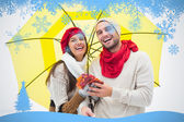 Attractive young couple in warm clothes — Stock Photo