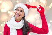 Composite image of festive brunette — Stockfoto