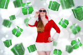 Composite image of cool santa girl wearing sunglasses — Stock Photo