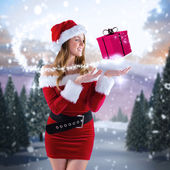 Sexy santa girl presenting with hand — Stock Photo