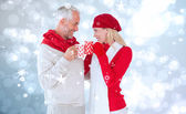 Happy winter couple with mugs — Стоковое фото