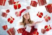 Composite image of sexy santa girl presenting with hands — Stok fotoğraf