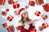Composite image of sexy santa girl presenting with hands — Stock Photo