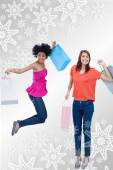 Teenage girl jumping with her shopping bags — Stock Photo