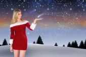 Pretty girl presenting in santa outfit — Photo