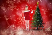 Composite image of pretty girl presenting in santa outfit — Foto Stock