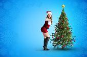 性感的圣诞老人女孩吹一个吻 — 图库照片