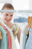 Beautiful female customer selecting clothes — Stock Photo