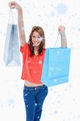 Teenage girl smiling and raising her shopping — Stock Photo