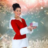 Pretty santa girl holding gift — Stock Photo