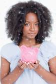 Young woman holding a pink piggy bank — Foto de Stock