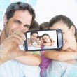 Smiling young family looking at camera — Stock Photo #53900501