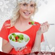 Young smiling woman eating a fresh salad — Stock Photo #53900583