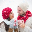 Attractive young couple in warm clothes — Stock Photo #53900647