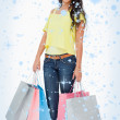 Beautiful woman student with shopping bags — Stock Photo #53901287