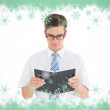 Geeky businessman reading from book — Stock Photo #53901809
